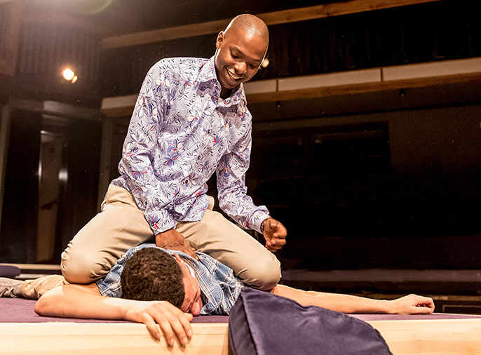 Dembe (Fiston Barek) and Sam (Julian Moore-Cook) in The Rolling Stone by Chris Urch, Orange Tree Theatre - photo by Manuel Harlan