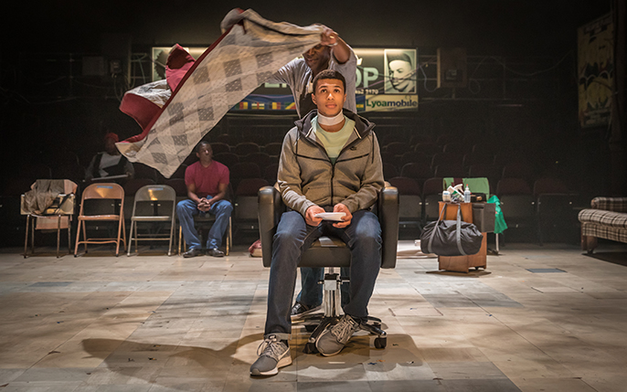 Cyril Nri (Emmanuel) Kwami Odoom (Ethan) in Barber Shop Chronicles at the National Theatre (c) Marc Brenner