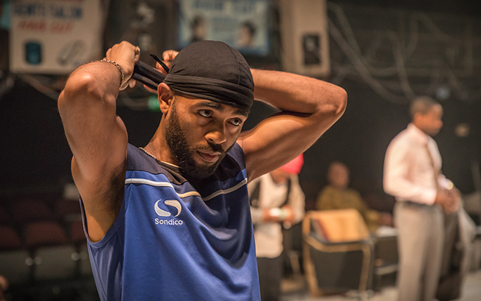 Anthony Welsh (Winston) in Barber Shop Chronicles at the National Theatre (c) Marc Brenner