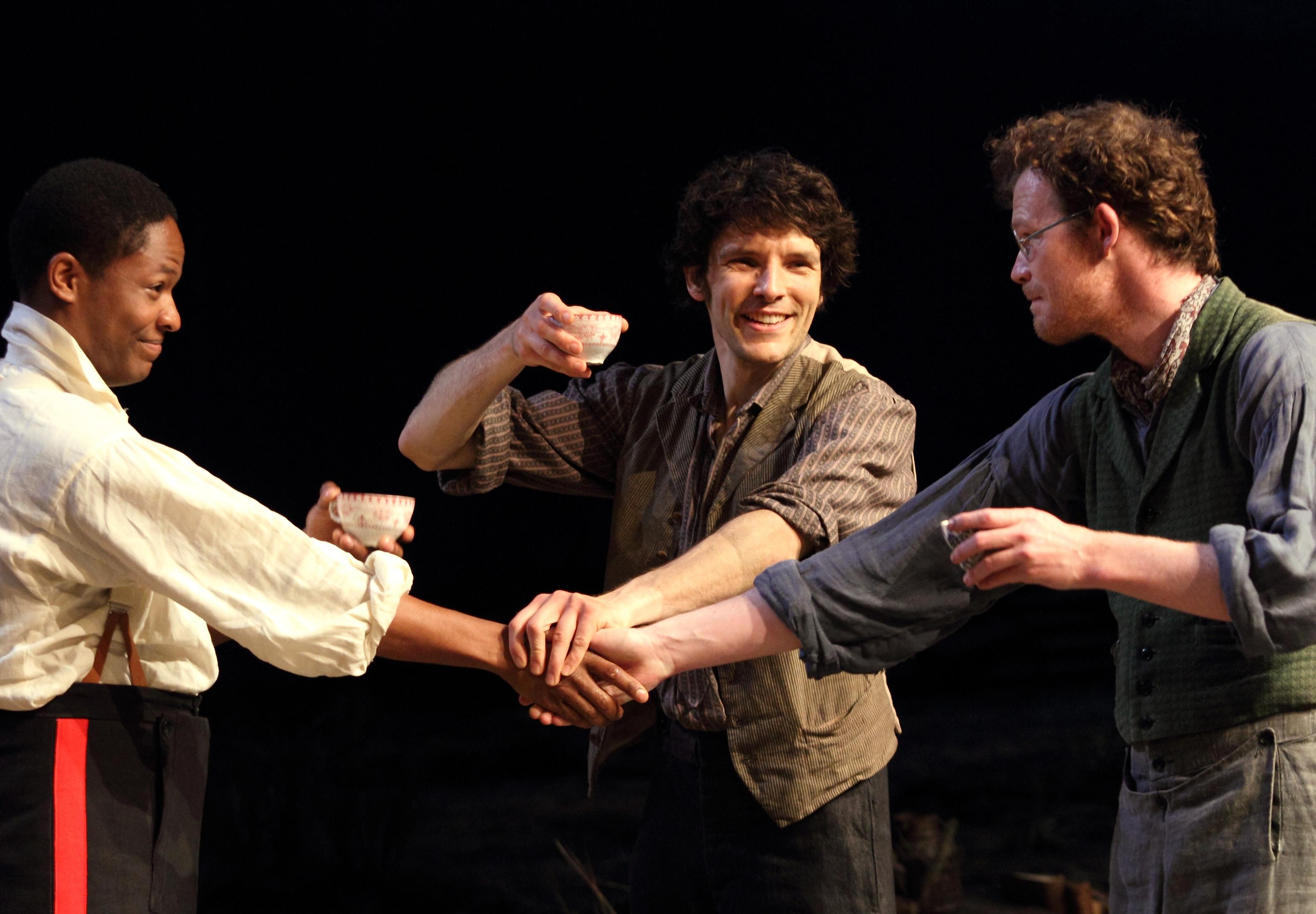 Adetomiwa Edun (Lieutenant Yolland), Colin Morgan (Owen), Seamus O'Hara (Manus). Image by Catherine Ashmore