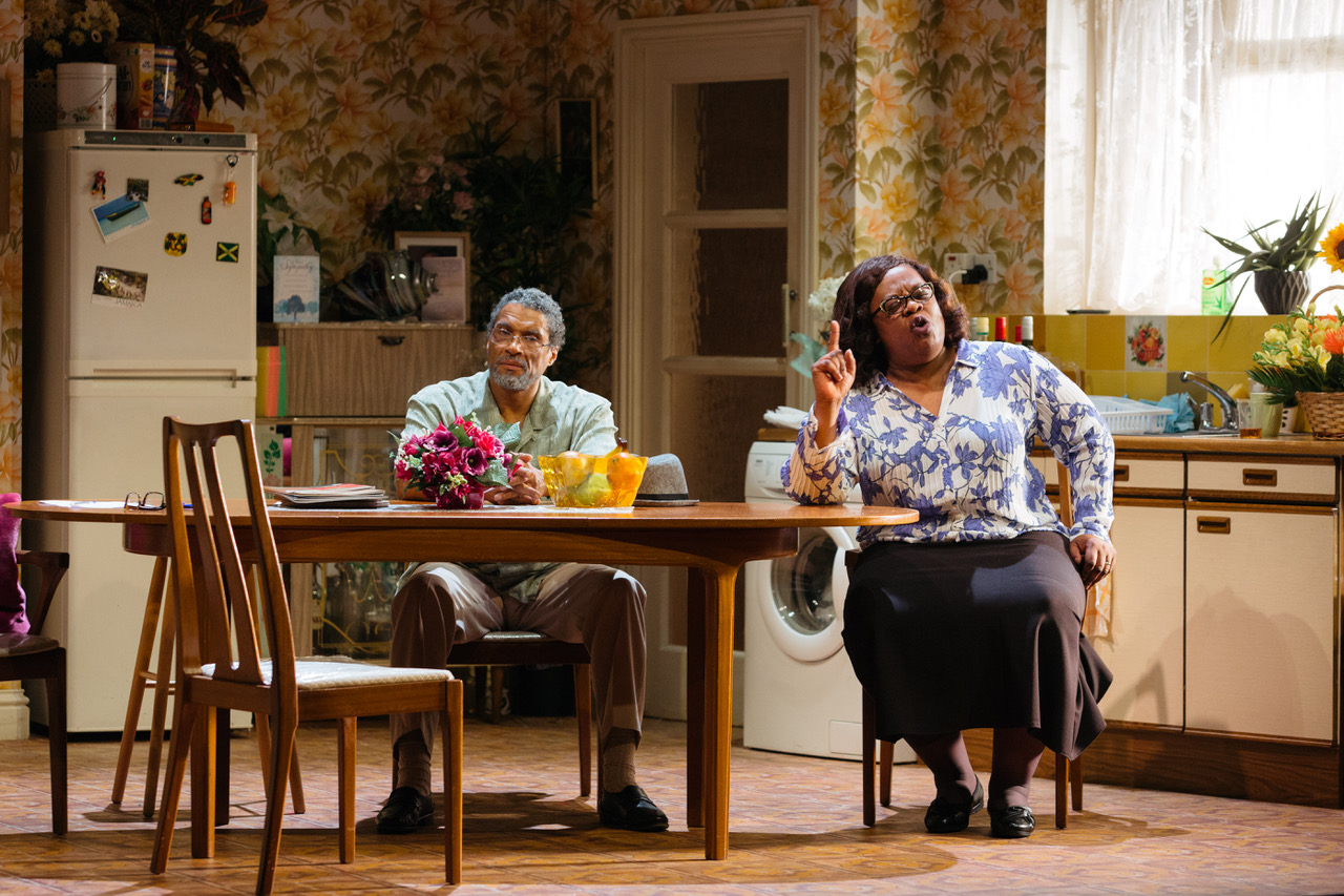 Cecilia Noble as Aunt Maggie and Ricky Fearon as Uncle Vince in Nine Night at the National Theatre (c) Helen Murray
