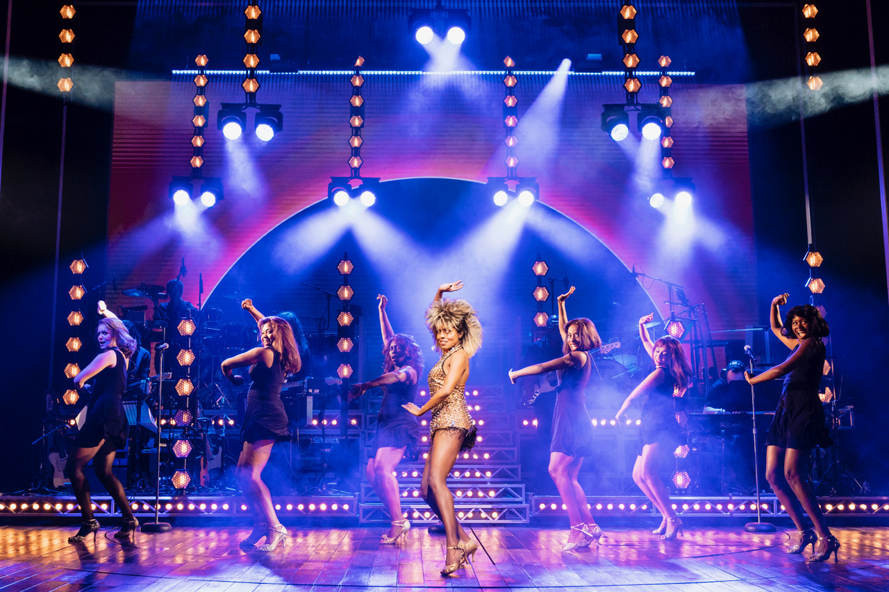 centre Adrienne Warren as Tina Turner. Photo by Manuel Harlan