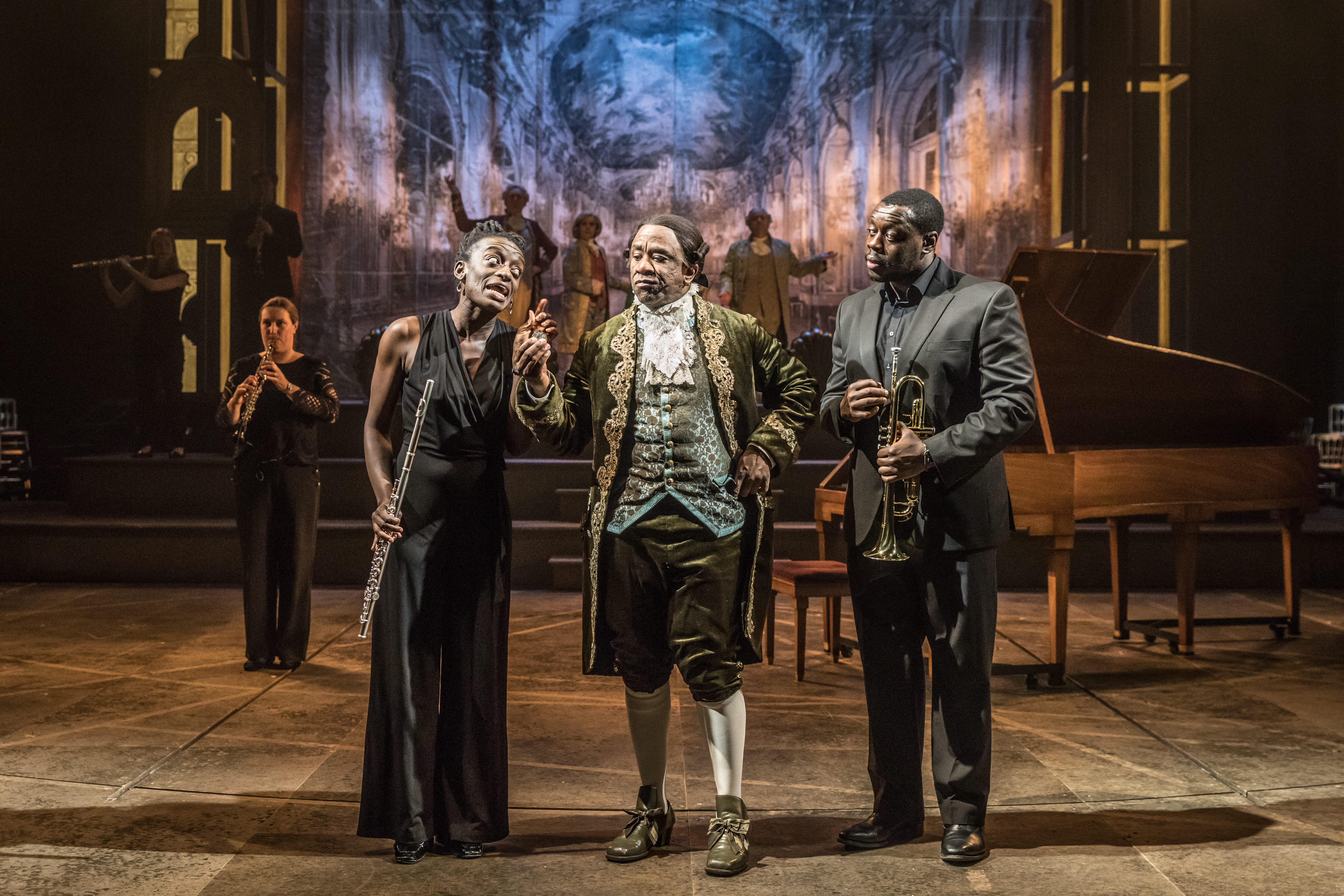 Sarah Amankwah as Venticelli, Lucian Msamati as Antonio Salieri and Ekow Quarty as Venticelli in Amadeus at the National Theatre (c) Marc Brenner