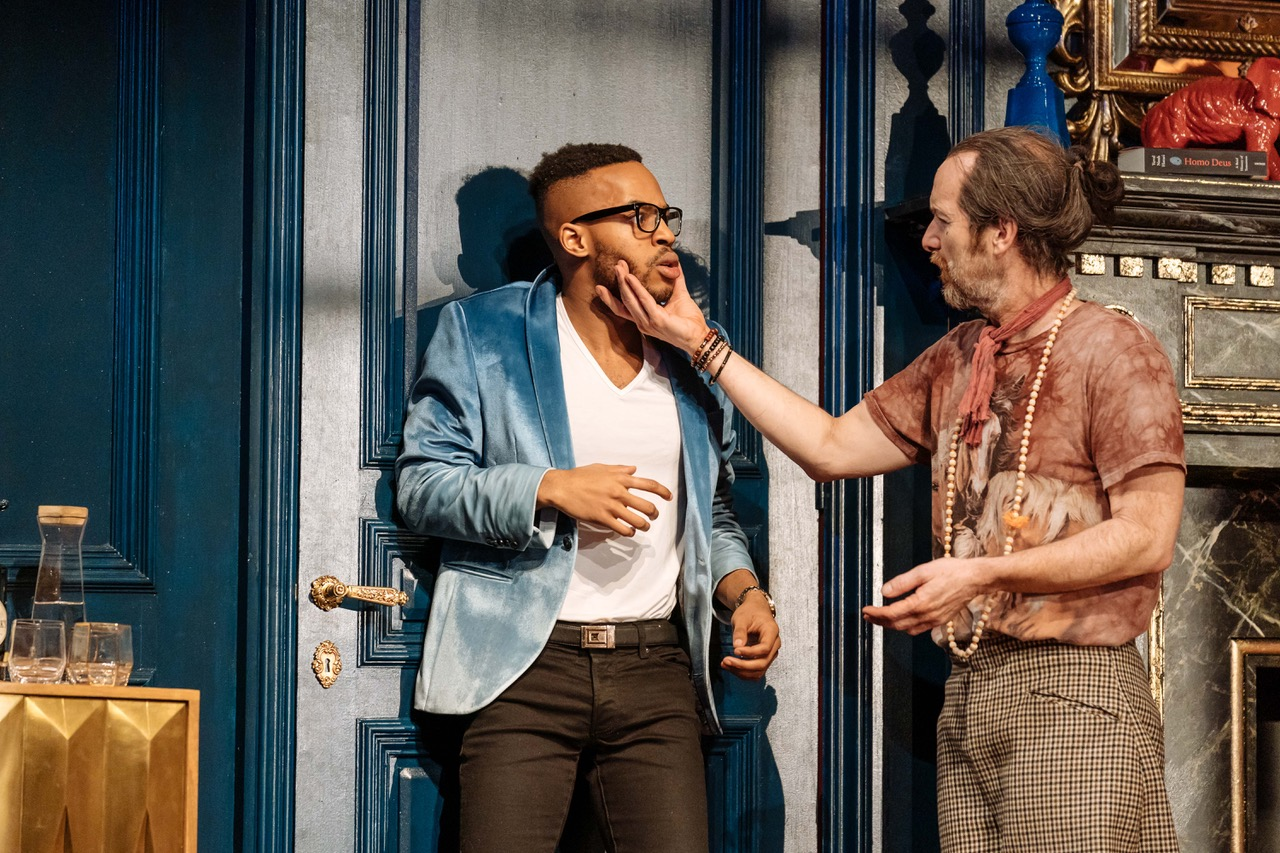 Enyi Okoronkwo, Denis O'Hare in Tartuffe by Molière in a new version by John Donnelly. [Image by Manuel Harlan]