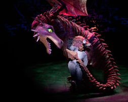 The Dragon and Richard Blackwood as Donkey  in Shrek The Musical. Photo by Helen Maybanks