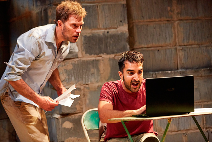 The Invisible Hand at The Tricycle Theatre. Daniel Lapaine (Nick), Parth Thakerar (Bashir). Photo by Mark Douet