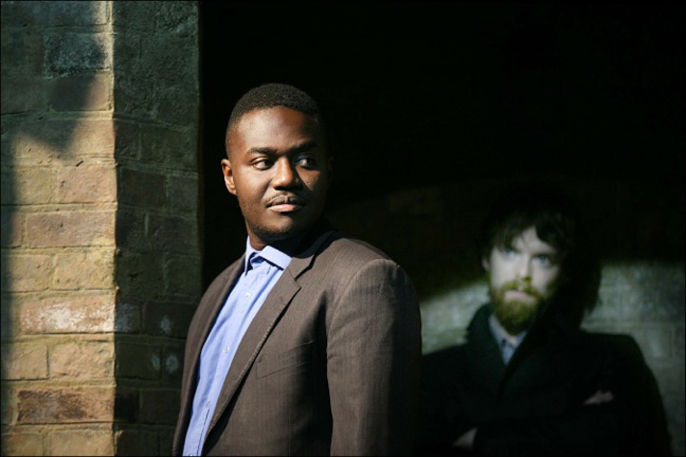 Foreground Babou Ceesay (Abina) and background Alexander Campbell (Warden) in The Serpent's Tooth Photographer Sheila Burnett