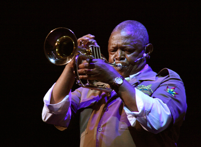 Hugh Masekela playing trumpet in Songs of Migration, Hackney Empire