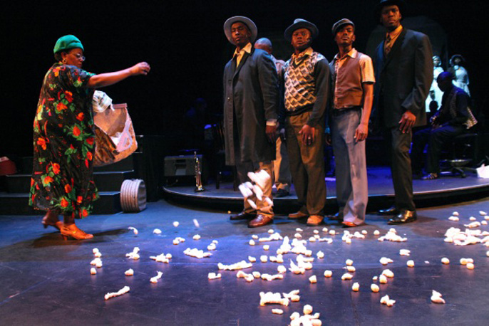 Sibongile Khumalo with male cast, Songs of Migration created by Hugh Masekela, Hackney Empire