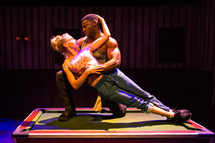 Kirsty Oswald (Desdemona) & Mark Ebulue (Othello) in Frantic Assembly's Othello. Credit Manuel Harlan