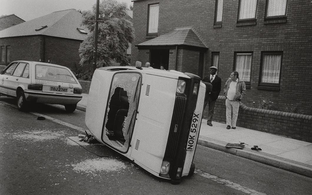 Handsworth Riots, the Lozells Road, Birmingham, photograph by Pogus Caesar, 1985, England. Museum no. E.1203-2012. © Pogus Caesar Victoria and Albert Museum, London. Supported by the National Lottery through the Heritage Lottery Fund