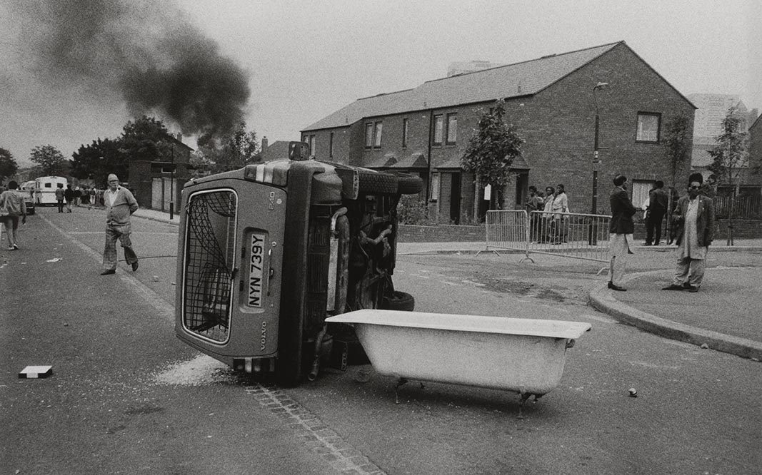 Handsworth Riots, photograph by Pogus Caesar, 1985, England. Museum no. E.1202-2012. © Pogus Caesar Victoria and Albert Museum, London. Supported by the National Lottery through the Heritage Lottery Fund.
