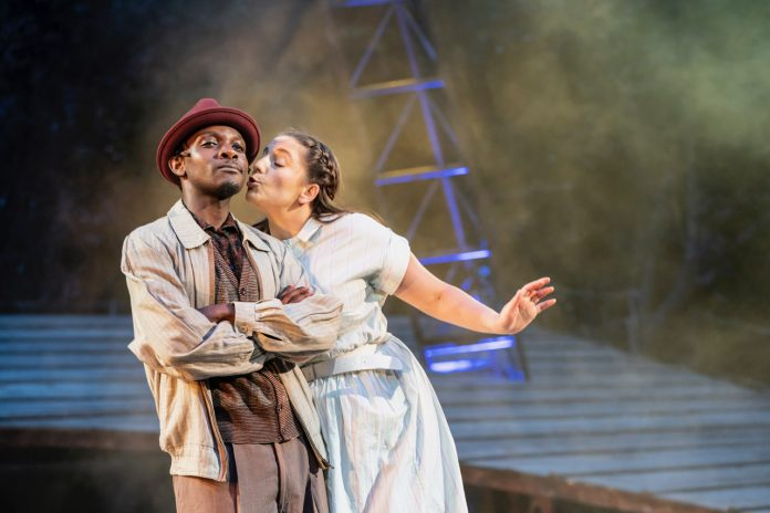 John Pfumojena and Christina Modestou as Enoch Snow and Carrie Pipperidge in Carousel at Regent's Park Open Air Theatre. Photo by Johan Persson